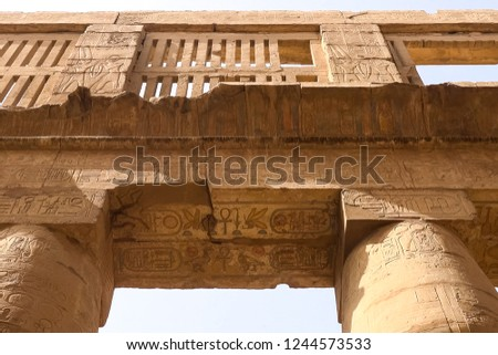 Egyptian hieroglyphs and drawings on the walls and columns. Egyptian language, The life of ancient gods and people in hieroglyphics and drawings #1244573533