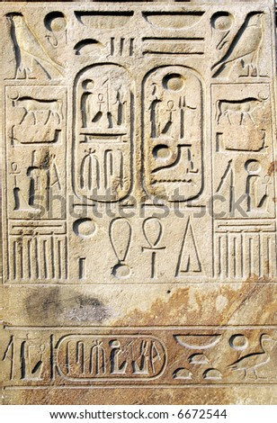 Egyptian hieroglyphs at stone bas-relief