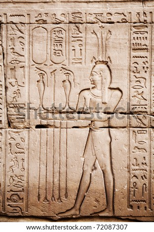 Egyptian images and hieroglyphs engraved on stone in Horus temple, Edfu, Egypt