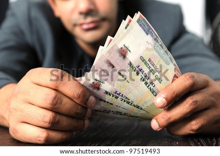 Egyptian man counting money in Egyptian currency