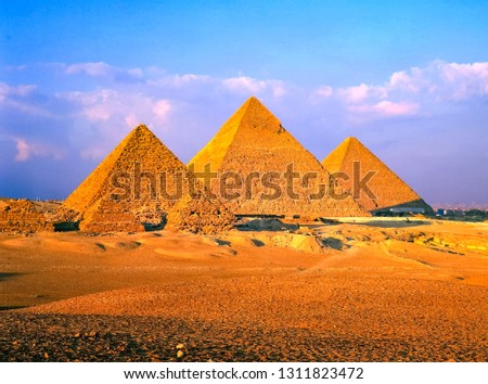 Egyptian pyramid in Giza. Architectural heritage of ancient Egyptian civilization. Ruins and statues of ancient Egypt.