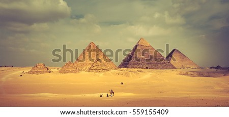 Egyptian pyramids of Giza Plateau: famous pyramid of Menkaure, Khafre,  Khufu and three smaller step pyramids. Panoramic view of Giza Pyramid Complex, idea of horizontal banner for travel to Egypt.