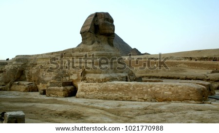 Egyptian Sphinx on the background of the Cheops pyramid #1021770988