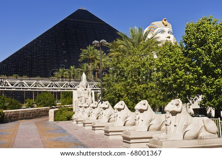 Egyptian statues in a row at Luxor Hotel and Casino in Las Vegas, Nevada - stock photo