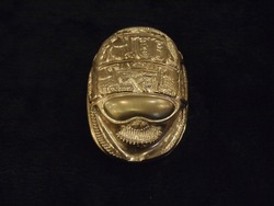 Egyptian style scarab isolated on a dark background