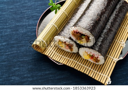 """Eho-maki are thick sushi rolls which is believed to bring good fortune if eaten while facing the year's """"Eho"""" (good luck direction) Japanese Traditional event 'Setsubun'"""