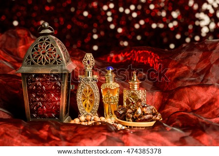 Eid and Ramadan theme background with dates and arabic lamp and red glitter