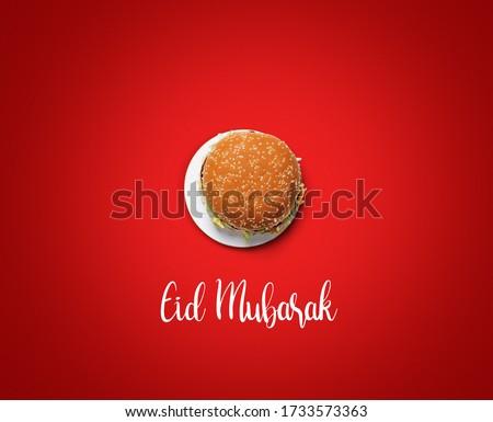 Eid Mubarak-Burger food and white plate shape of eid or Ramadan moon concept of eid celebration. Burger on red background restaurant Eid concept.