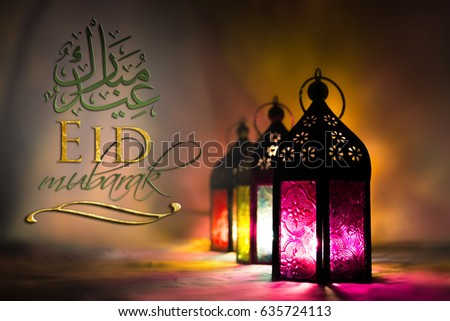 Eid Mubarak greeting - islamic muslim holiday Ramadan background with eid lantern or lamp #635724113