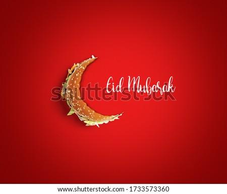 Eid Mubarak-Half bite Burger food  shape of eid or Ramadan moon concept of eid celebration. Burger on red background restaurant Eid concept.