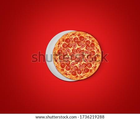 Eid Mubarak-Pizza food and white plate shape of eid or Ramadan moon concept of eid celebration. Pizza on red background restaurant Eid concept.