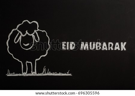 Eid Mubarak text on Black Board #696305596