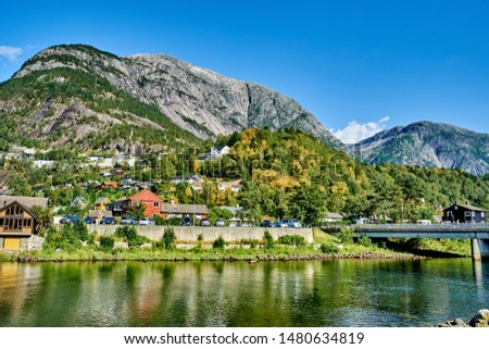 Eidfjord, Norway is situated at the end of the Eid Fjord, an inner branch of the large Hardangerfjorden. The village of Eidfjord is a major cruise ship port of call. Eidfjord has several tourist sites