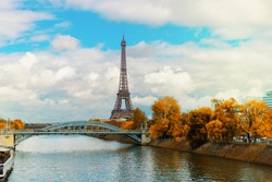 eiffel tour over Seine river with yellow trees, Paris, France at fall