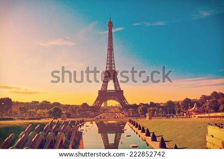 Eiffel Tower and fountain at Jardins du Trocadero at sunrise in Paris, France. Travel background with retro vintage instagram filter