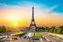 Eiffel Tower and fountains near it at dawn in Paris, France