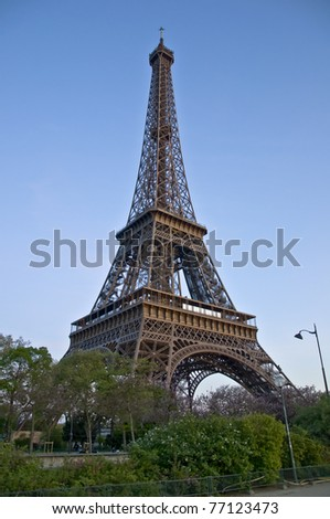 Eiffel Tower at afternoont. A symbol of Paris against the dark sky.