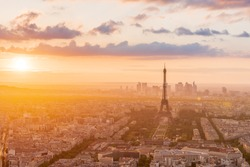 Eiffel Tower at sunset from enhanced view, Paris skyline in the background