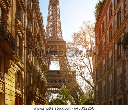Eiffel tower between buildings in the last rays of the sun. Paris.France. #645012250
