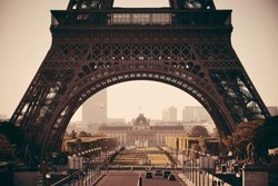 Eiffel Tower closeup with street as the famous city landmark in Paris