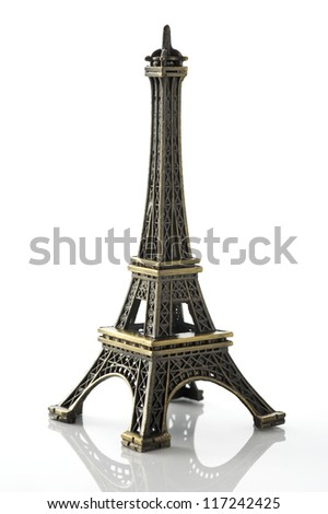 eiffel tower figurines on white background