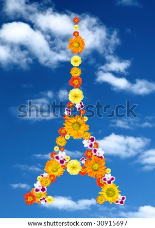 eiffel tower from flowers against blue sky