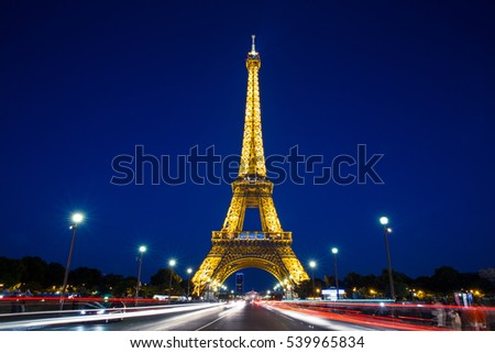 Eiffel Tower in Paris at night with lights on #539965834