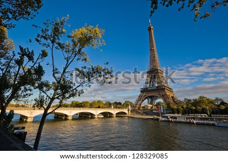 Stock Photo Eiffel Tower in Paris, France - overlooking Seine river at sunset