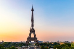 Eiffel tower in summer, Paris, France. Scenic panorama of the Eiffel tower under the blue sky.