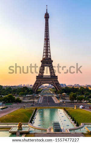Eiffel tower in summer, Paris, France. Scenic panorama of the Eiffel tower under the blue sky. View of the Eiffel Tower in Paris, France in a beautiful summer day. Paris, France.