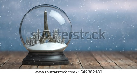 Eiffel tower in the snow globe glass ball. Travel or trip to Paris and France in winter for celebrate Christmas. 3d illustration