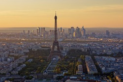 Eiffel Tower, Les Invalides and business district of Defense at orange sunset, as seen from Montparnasse Tower, Paris, France