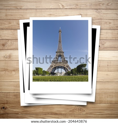 Eiffel Tower memory on photo frame brown wood plank background
