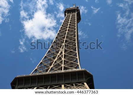 Eiffel Tower Paris France.  A person looking at the Eiffel Tower. person visits Paris #446377363