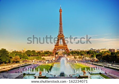 Eiffel Tower seen from fountain at Jardins du Trocadero at a sunny summer day, Paris, France