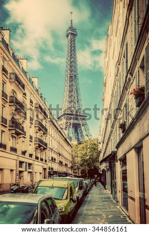 Eiffel Tower seen from the street in Paris, France. Vintage, retro
