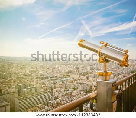 Eiffel Tower telescope overlooking for Paris.