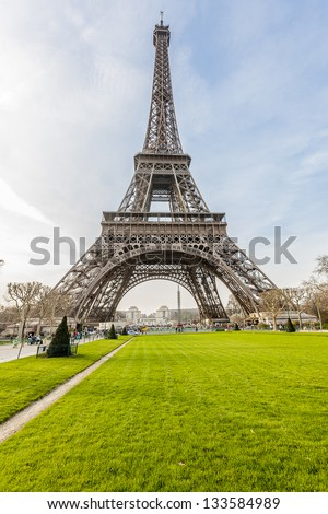 Eiffel Tower. Tour Eiffel located on Champ de Mars in Paris, named after engineer Gustave Eiffel. Eiffel Tower is tallest structure in Paris and most visited monument in the world. France.