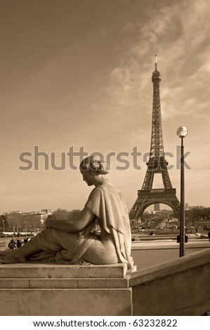 Eiffel tower with a woman's sculpture on the foreground (Paris, France)