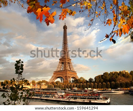 Eiffel Tower with autumn leaves in Paris France