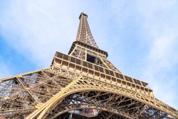 Eiffel Tower with blue sky background closeup view