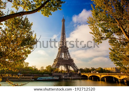 Eiffel Tower with boat on Seine in Paris France