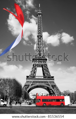Eiffel Tower with flag and bus in Paris, France