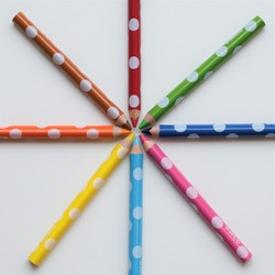 Eight colored pencils stacked in a radius