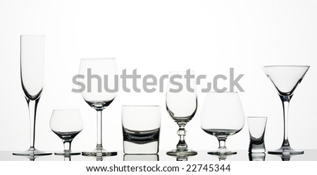 Eight different glasses on white background