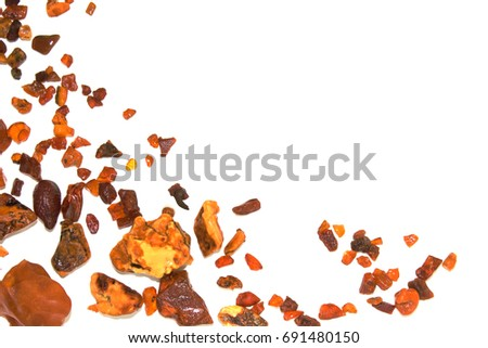 Eight different pieces of amber on a white background. Amber of various colors and structure and shapes. Transparent and opaque pieces of amber. Natural amber #691480150