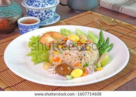 Eight immortals fried rice (or Baxian rice), Fragrance fried rice with chestnut, ginkgo biloba, mushroom, lotus seeds, sweet pea, taro, carrot and corns. Vegetarian food for vegetarian festival.