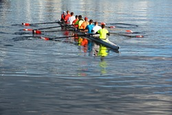 Eight man rowing skull out practising on the water