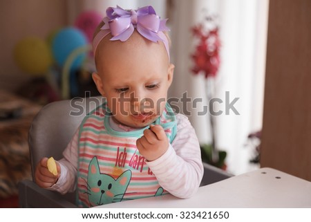 Eight month baby girl eating blackberry #323421650