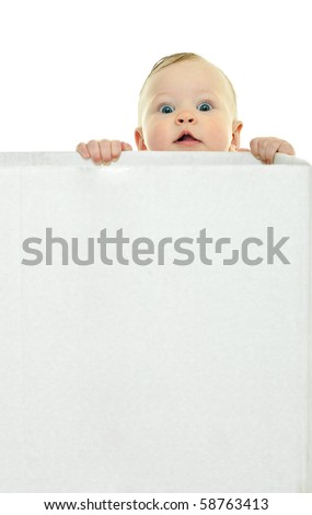 eight month baby holds on to the white box